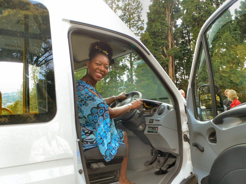 Chancellor, Floella Benjamin presents a new minibus paid for from the proceeds of car parking charges