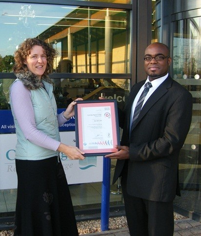 Sarah Bearpark receives CRC's ISO 14001 accreditation from Nii Lante Wallace of certification body SGS