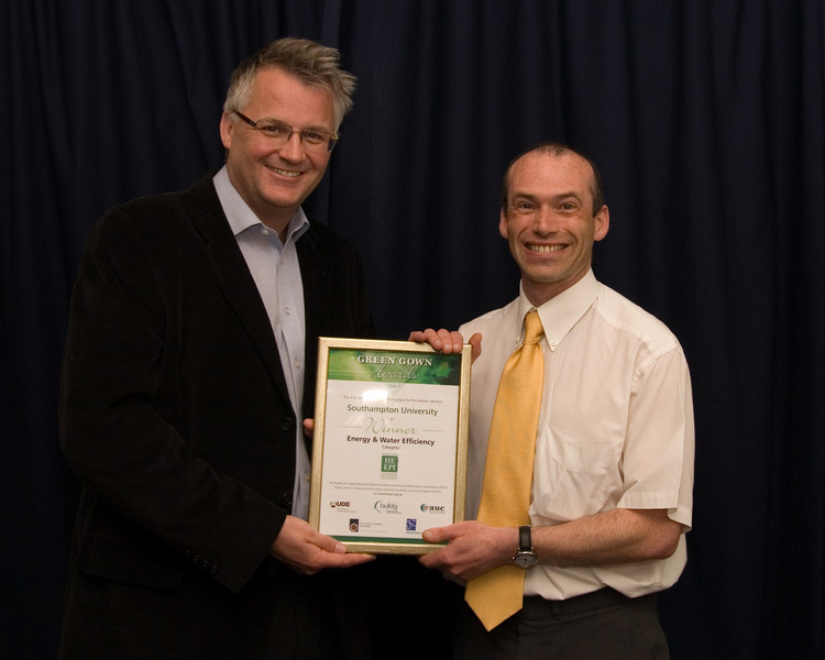 Dr Neil Smith, Environment Manager receiving the Green Gown award for Energy and Efficiency for the CHP and district heating system from Alan Knight at the EAUC 2007 conference.